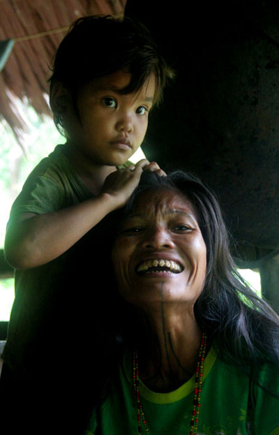 mentawai tribe woman sharp teeth why you should visit Sumatra